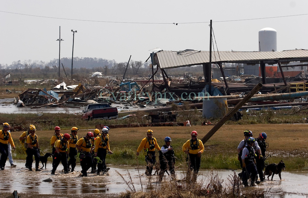 26th Sept, 2005. Cameron, Louisiana. Hurricane Rita aftermath. <br /> Members of the Las Vegas, Nevada Task Force 1, a FEMA search and rescue team scour the destroyed remains of houses and business in Cameron, Louisiana for any signs of life two days after the storm ravaged the small town.<br /> Photo; &copy;Charlie Varley/varleypix.com