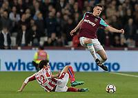 Football - 2017 / 2018 Premier League - West Ham United vs Stoke City<br /> <br /> Declan Rice (West Ham United)  leaps over the challenge of Ramadan Sobhi (Stoke City) at the London Stadium<br /> <br /> COLORSPORT/DANIEL BEARHAM