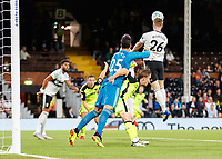 Football - 2018 / 2019 EFL Carabao Cup (League) Cup - Fulham vs. Exeter City<br /> <br /> Alfie Mawson (Fulham FC) making his Fulham debut rises high to clear the corner at Craven Cottage.<br /> <br /> COLORSPORT/DANIEL BEARHAM