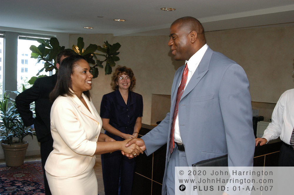 Magic Johnson meets with members of Glaxo Smith Kline on Wednesday July 9, 2003.