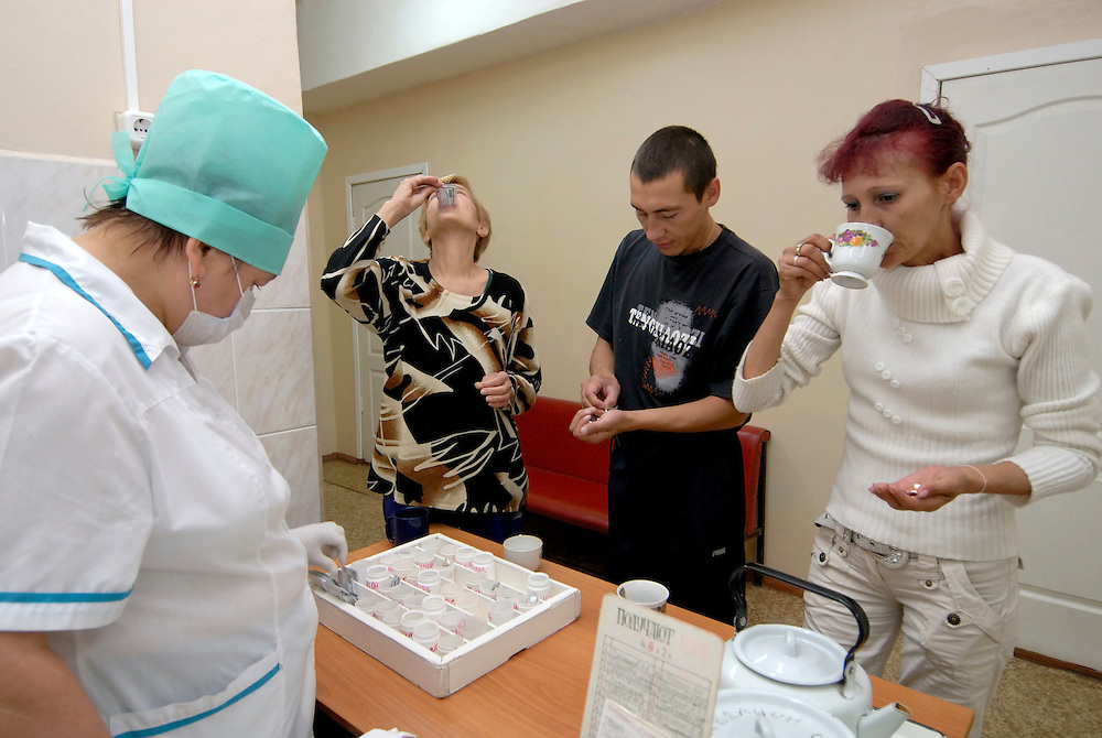 Russia.Tomsk (Siberia). 24.08.2007. TB Hospital. MDR (Multi Drug Resistant) ward. Patients receiving and taking their medication.