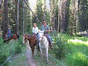 James & Kay Pratt riding horseback in Frank Church River of No Return Wilderness Area just outside Sulphur Creek Ranch in central Idaho