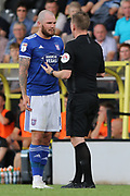 Referee Ross Joyce talks with Ipswich Town midfielder James Norwood during the EFL Sky Bet League 1 match between Burton Albion and Ipswich Town at the Pirelli Stadium, Burton upon Trent, England on 3 August 2019.
