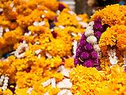 11 JULY 2011 - BANGKOK, THAILAND:   Flower garlands left as offerings at the Erawan Shrine in Bangkok. The Erawan Shrine (in Thai San Phra Phrom) is a Hindu shrine in Bangkok, Thailand that houses a statue of Phra Phrom, the Thai representation of the Hindu creation god Brahma. A popular tourist attraction, it often features performances by resident Thai dance troupes, who are hired by worshippers in return for seeing their prayers at the shrine answered. On 21 March 2006, a man vandalised the shrine and was subsequently killed by bystanders. The shrine is located by the Grand Hyatt Erawan Hotel, at the Ratchaprasong intersection of Ratchadamri Road in Pathum Wan district, Bangkok, Thailand. It is near the Bangkok Skytrain's Chitlom Station, which has an elevated walkway overlooking the shrine. The area has many shopping malls nearby, including Gaysorn, CentralWorld and Amarin Plaza. The Erawan Shrine was built in 1956 as part of the government-owned Erawan Hotel to eliminate the bad karma believed caused by laying the foundations on the wrong date..The hotel's construction was delayed by a series of mishaps, including cost overruns, injuries to laborers, and the loss of a shipload of Italian marble intended for the building. Furthermore, the Ratchaprasong Intersection had once been used to put criminals on public display. An astrologer advised building the shrine to counter the negative influences. The Brahma statue was designed and built by the Department of Fine Arts and enshrined on 9 November 1956. The hotel's construction thereafter proceeded without further incident. In 1987, the hotel was demolished and the site used for the Grand Hyatt Erawan Hotel.     PHOTO BY JACK KURTZ