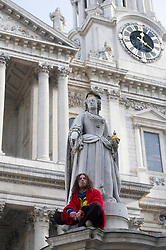 St Paul's Cathedral. Pic Shows A man on the monument outside St Paul's he is demonstrating against the Church's lack of help for the homeless, London, UK, 18 February, 2013. Photo by: i-Images