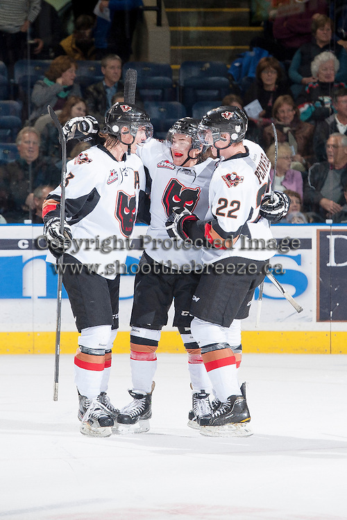 KELOWNA, CANADA - OCTOBER 22: The Calgary Hitmen celebrate a goal against the Kelowna Rockets on October 22, 2013 at Prospera Place in Kelowna, British Columbia, Canada.   (Photo by Marissa Baecker/Shoot the Breeze)  ***  Local Caption  ***