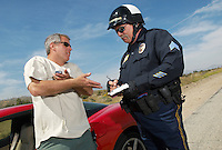 Traffic cop talking with driver of sports car