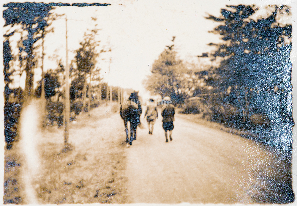 people walking with horse Japan ca 1930s