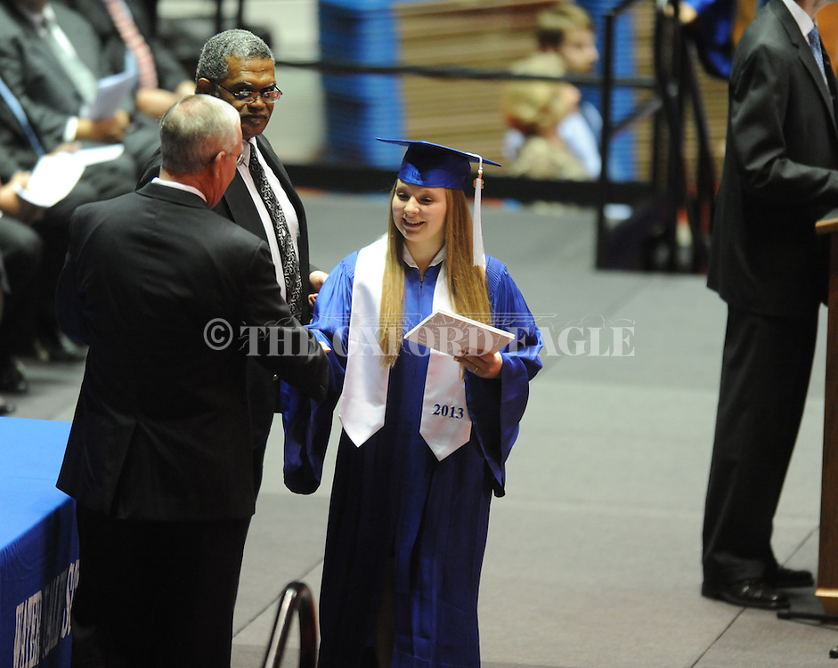 """Erica Landry receives a diploma as Water Valley holds its graduation ceremony at the C.M. """"Tad"""" Smith Coliseum in Oxford, Miss. on Thursday, May 23, 2013."""