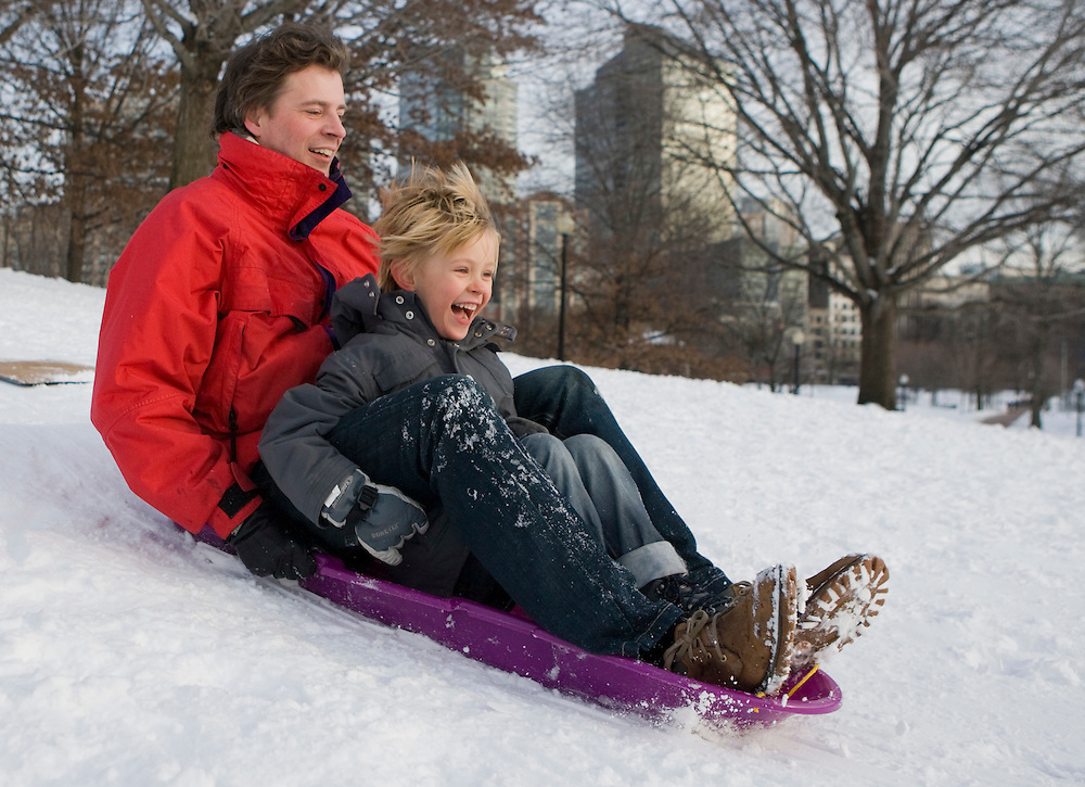 (20110122, Boston, Massachusetts)..Harold Brink and son Leyon, 5, of Beacon Hill sled in the Boston Common in Boston, Massachusetts on Saturday, January 22, 2011.  ..Photo by Brooks Canaday..