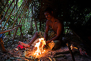 A Maniq man prepares darts for a hunting trip.<br /> <br /> Evidence suggests that the Maniq, a Negrito tribe of hunters and gatherers, have inhabited the Malay Peninsula for around 25,000 years. Today a population of approximately 350 maniq remain, marooned on a forest covered mountain range in Southern Thailand. Whilst some have left their traditional life forming small villages, the majority still live the way they have for millennia, moving around the forest following food sources. <br /> <br /> Quiet and reclusive they are little known even in Thailand itself but due to rapid deforestation they are finding it harder to survive on the forest alone and are slowly being forced to move to its peripheries closer to Thai communities.