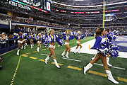The Dallas Cowboys cheerleaders come onto the field before the 2017 NFL week 3 preseason football game against the Oakland Raiders, Saturday, Aug. 26, 2017 in Arlington, Tex. The Cowboys won the game 24-20. (©Paul Anthony Spinelli)