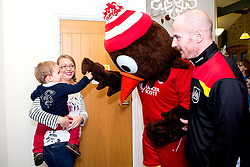 Scrumpy the mascot gives out a high five during Bristol City's visit to the Children's Hospice South West at Charlton Farm - Mandatory by-line: Robbie Stephenson/JMP - 21/12/2016 - FOOTBALL - Children's Hospice South West - Bristol , England - Bristol City Children's Hospice Visit