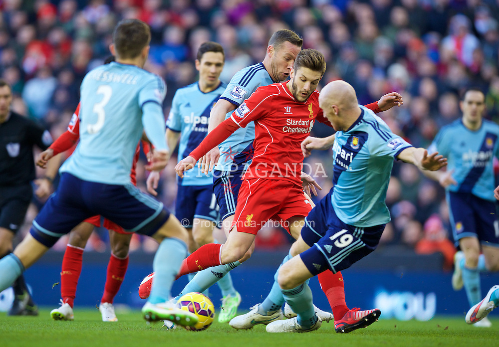 LIVERPOOL, ENGLAND - Saturday, January 31, 2015: Liverpool's Adam Lallana in action against West Ham United's James Collins during the Premier League match at Anfield. (Pic by David Rawcliffe/Propaganda)