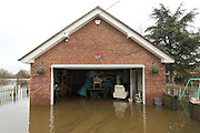 Flooded garage on Ham Island on the river Thames near Old Windsor. Thames Valley. UK
