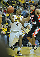 December 04 2010: Iowa Hawkeyes guard/forward Roy Devyn Marble (4) passes the ball by Idaho State Bengals forward/center Abner Moreira (21) during the second half of their NCAA basketball game at Carver-Hawkeye Arena in Iowa City, Iowa on December 4, 2010. Iowa won 70-53.