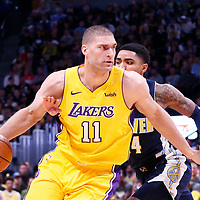 09 March 2018: Los Angeles Lakers center Brook Lopez (11) drives past Denver Nuggets guard Gary Harris (14) during the Denver Nuggets125-116 victory over the Los Angeles Lakers, at the Pepsi Center, Denver, Colorado, USA.