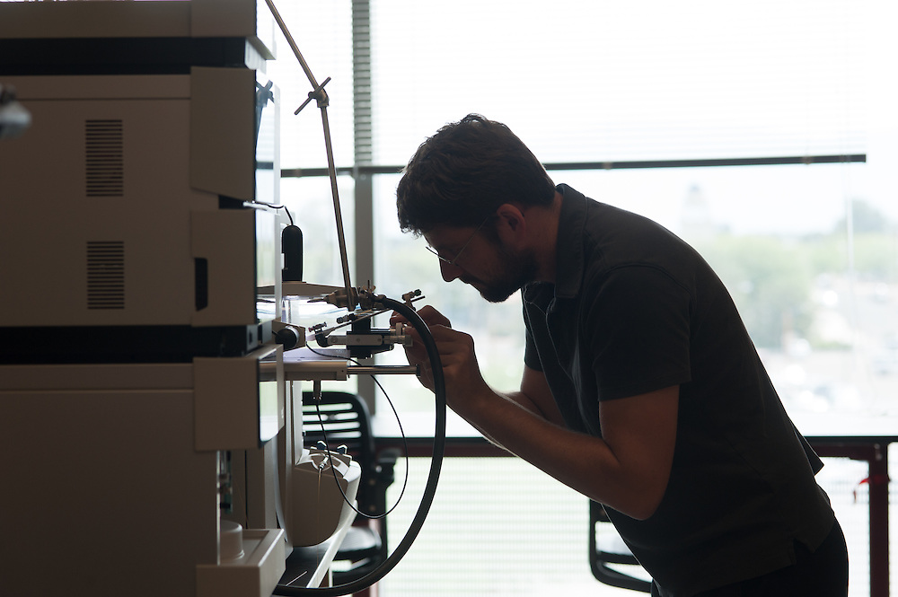 Researcher checking lab equipment