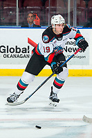 KELOWNA, BC - MARCH 7: Ethan Ernst #19 of the Kelowna Rockets skates with the puck against the Lethbridge Hurricanes at Prospera Place on March 7, 2020 in Kelowna, Canada. (Photo by Marissa Baecker/Shoot the Breeze)