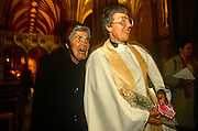 A recently-ordained woman priest enjoys a humerous moment with her mother after historical ceremony in Bristol Cathedral.