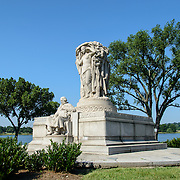 John Ericsson National Memorial Wide Shot. The John Ericsson National Memorial, on the bank of the Potomac River near the Lincoln Memorial, is a monument to Civil War naval engineer John Ericsson, the designer of the breakthrough iron-clad naval vessel USS Monitor. The memorial was designed by architect Albert Randolph Ross and sculpted by James Earle Fraser from the same pink granite used in the Lincoln Memorial. Because Ericsson was Swedish-born, the memorial consists of a combination of symbolic elements from his birthplace and his adopted homeland.