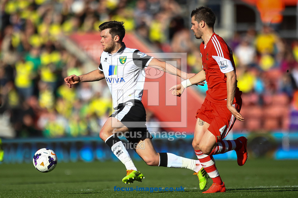Jonathan Howson of Norwich City and Morgan Schneiderlin of Southampton compete for the ball during the Barclays Premier League match at the St Mary's Stadium, Southampton<br /> Picture by Daniel Chesterton/Focus Images Ltd +44 7966 018899<br /> 15/03/2014