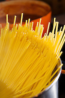 linguini pasta noodles in hot water to cook