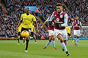 Burton Albion striker Lucas Akins (10) and Aston Villa defender Jordan Amavi (23) during the EFL Sky Bet Championship match between Aston Villa and Burton Albion at Villa Park, Birmingham, England on 26 December 2016. Photo by Richard Holmes.