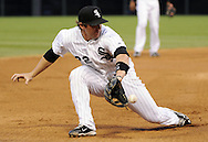 CHICAGO - JUNE 06:  Brent Morel #22 of the Chicago White Sox makes a back handed catch on a ball hit by Jack Wilson #2 of the Seattle Mariners in the fifth inning on June 6, 2011 at U.S. Cellular Field in Chicago, Illinois.  Morel threw out Wilson on the play.  The White Sox defeated the Mariners 3-1.  (Photo by Ron Vesely)  Subject:  Brent Morel;Jack Wilson