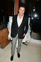 ANDRE BALAZS at a dinner to celebrate the publication of Obsessive Creative by Collette Dinnigan hosted by Charlotte Stockdale and Marc Newson held at Mr Chow, Knightsbridge, London on 9th February 2015.