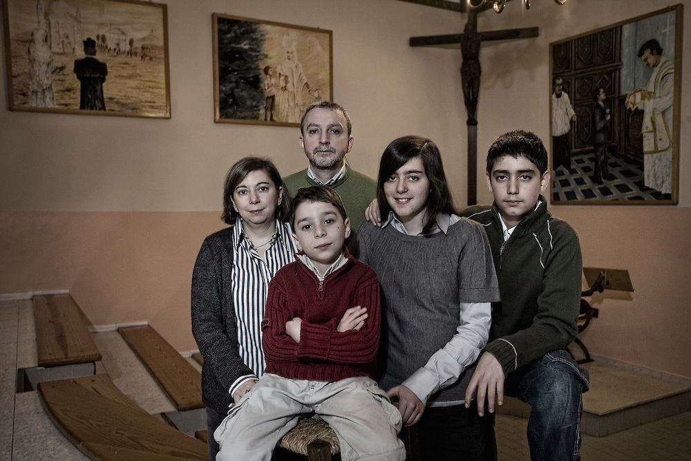 "Family of families is a project to celebrate the 150th anniversary of the first ""Oratorio"" of Maria Ausiliatrice in Turin. The essence of the Salesian congregation is living as in a family. The 100 portraits of the families connected to the Don Bosco Foundation would represent this charisma."
