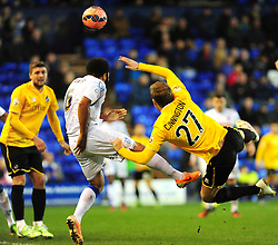 Tranmere Rovers's Marcus Holness clears from Bristol Rovers' Adam Cunnington - Photo mandatory by-line: Neil Brookman/JMP - Mobile: 07966 386802 - 08/11/2014 - SPORT - Football - Birkenhead - Prenton Park - Tranmere Rovers v Bristol Rovers - FA Cup - Round One