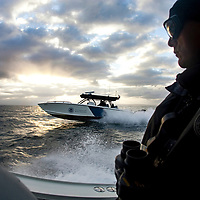 "Mark Allen White, Supervisory Marine Interdiction Agent with Customs and Border Protection, .San Diego Air & Marine Branch, patrols the waters near the US/Mexico border for undocumented immigrants in the early morning hours. The unit is also on patrol for gun smugglers hauling firearms into Mexico which is helping to fuel the Narco wars raging in Mexico. For more images, search for ""immigration by air and sea"". Please contact Todd Bigelow directly with your licensing requests. PLEASE CONTACT TODD BIGELOW DIRECTLY WITH YOUR LICENSING REQUEST. THANK YOU!"