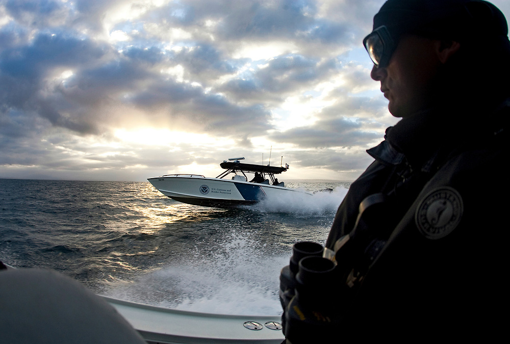 """Mark Allen White, Supervisory Marine Interdiction Agent with Customs and Border Protection, .San Diego Air & Marine Branch, patrols the waters near the US/Mexico border for undocumented immigrants in the early morning hours. The unit is also on patrol for gun smugglers hauling firearms into Mexico which is helping to fuel the Narco wars raging in Mexico. For more images, search for """"immigration by air and sea"""". Please contact Todd Bigelow directly with your licensing requests. PLEASE CONTACT TODD BIGELOW DIRECTLY WITH YOUR LICENSING REQUEST. THANK YOU!"""
