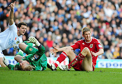 Bristol City's Jon Stead catches Leeds United Goalkeeper, Kasper Schmeichel as he stretches for the ball - Photo mandatory by-line: Joe Meredith/JMP - 13/11/2010 - SPORT - FOOTBALL - Championship - Leeds United v Bristol City  - Elland Road, Leeds, England