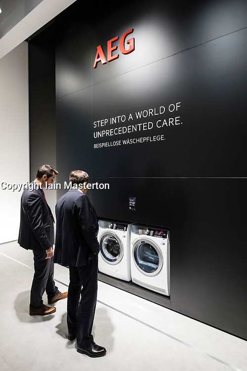 Men looking at new AEG washing machines at 2016  IFA (Internationale Funkausstellung Berlin), Berlin, Germany