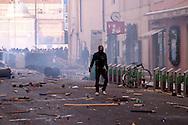 Roma 14 Dicembre 2010.<br /> Manifestazione contro il Governo Berlusconi. un manifestante fronteggia la polizia in Via del corso<br /> Rome December 14, 2010.<br /> Demonstration against the Berlusconi government. Protesters attack police
