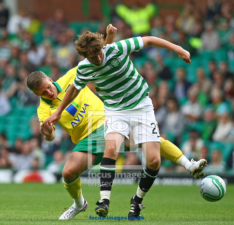 Picture by Paul Chesterton/Focus Images Ltd +44 7904 640267.24/07/2012.Paddy McCourt of Celtic and Steve Morison of Norwich in action during the Friendly match at Celtic Park, Glasgow.