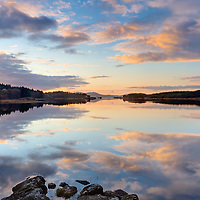 Peaceful, mirroring lake surface of Lough Currane near Waterville, County Kerry, Ireland along the Wild Atlantic Way and the Skellig Coast<br />