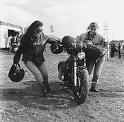 Two biker women pushing a bike at a Rock and Blues festival