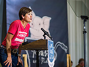 "15 JUNE 2019 - BOONE, IOWA: Governor KIM REYNOLDS (R-IA), speaks on behalf of US Senator Joni Ernst, (R-IA) during ""Joni's Roast and Ride,"" an annual motorcycle ride / barbecue fund raiser hosted by Ernst. Ernst, Iowa's junior US Senator, kicked off her re-election campaign during the ""Roast and Ride"", an annual fund raiser and campaign event has she held since originally being elected to the US Senate in 2014.   PHOTO BY JACK KURTZ"