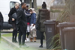 © Licensed to London News Pictures. 04/12/2017. London, UK. Visibly upset unidentified people arrive outside a house where police are investigating a double murder in Deptford, East London where the bodies of a man believed to be in his 60s and a woman believed to be in her 40s were discovered. Photo credit: Peter Macdiarmid/LNP