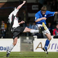 Ayr Utd v St Johnstone...24.04.04  <br />Ross Forsyth clears from Stuart Kean<br /><br />Picture by Graeme Hart.<br />Copyright Perthshire Picture Agency<br />Tel: 01738 623350  Mobile: 07990 594431