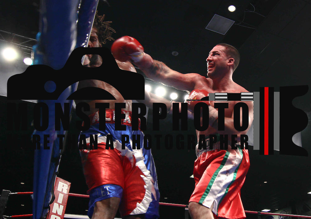 Cruiserweight boxing pro Alex Guerrero of Salisbury, Md (RIGHT) in action during champs at the chase against Cruiserweight boxing pro Tony Ferrante Friday, Nov 21, 2014 at The Case Center on The River Front in Wilmington, Del.