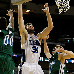 November 27, 2011; New Orleans, LA; San Diego Toreros forward Chris Manresa (34) shoots over Tulane Green Wave forward Josh Davis (00) and center Tomas Bruha (41) during the second half of the Hoops for Hope Classic at the New Orleans Arena. Tulane defeated San Diego 65-46. Mandatory Credit: Derick E. Hingle-US PRESSWIRE