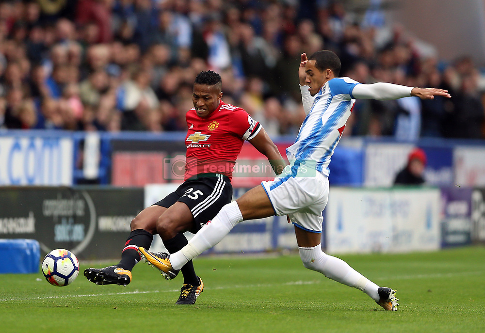Manchester United's Antonio Valencia (left) and Huddersfield Town's Tom Ince battle for the ball during the Premier League match at the John Smith's Stadium, Huddersfield.