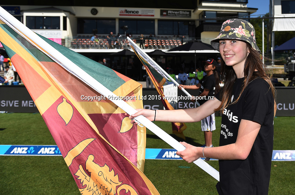 Flag bearer for NZ Cricket's Charity Heart Kids on day 1 of the 2nd cricket test match between New Zealand Black Caps and Sri Lanka at University Oval, Dunedin, New Zealand. Friday 18 December 2015. Copyright photo: Andrew Cornaga / www.photosport.nz
