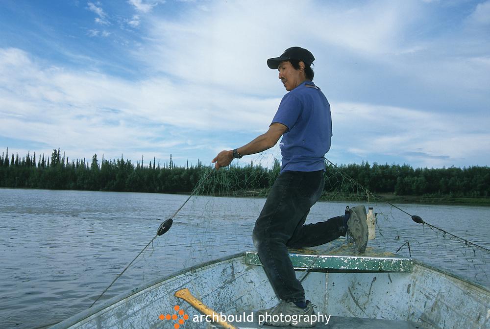 Fisherman setting his nets, Yukon