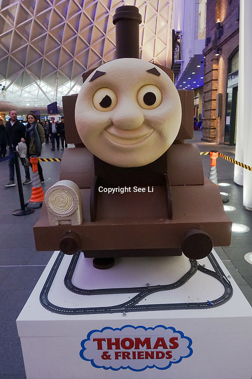London, England, UK. 15th Apr, 2017. To celebrate Easter, a six foot chocolate sculpture of Thomas the Tank Engine is displayed on the concourse of King's Cross Station in London. by See Li