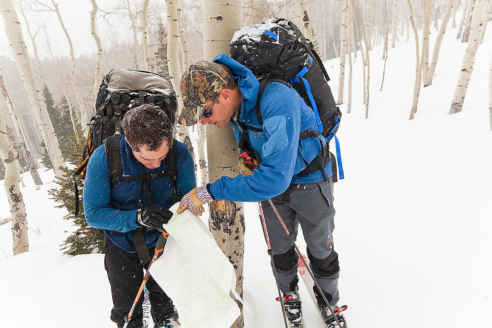 Judd MacRae (left) and Sterling Roop check their topo map in an aspen grove in Uncompahgre National Forest, Colorado.